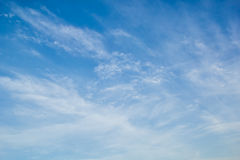 Blue sky with light white cirrus clouds. Blue sky with delicate arabesques of light white cirrus clouds stock image