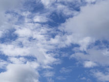 Blue sky with light  white clouds background Stock Image