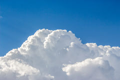 Blue sky with a lot of white puffy clouds Stock Photos