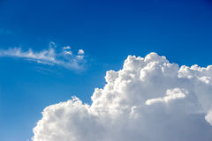 Blue sky with a lot of white puffy clouds Stock Photography