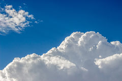 Blue sky with a lot of white puffy clouds Royalty Free Stock Image