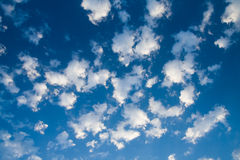 Blue sky and lots small white clouds, may be used Royalty Free Stock Photo