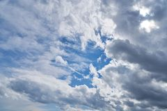 Blue sky with many white clouds. In the day Royalty Free Stock Image