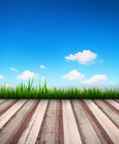 Blue sky with meadow and wooden floor Stock Images