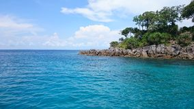Blue sky middle of the sea and Small island, royalty free stock image
