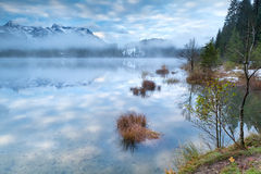 Blue sky in misty morning on Barmsee in Alps Royalty Free Stock Photos