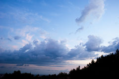 Blue sky, the moon, beautiful clouds. Royalty Free Stock Image