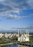 Blue sky Mosque. The white mosque of Adana under a cloudy blue sky stock photo