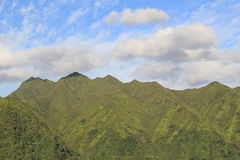 Blue sky and mountains. Blue sky and clouds over mountains in Oahu, Hawaii Stock Photography