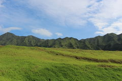 Blue sky and mountains. Blue sky and clouds over mountains in Oahu, Hawaii Royalty Free Stock Image