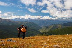 Blue sky, mountains and men. Royalty Free Stock Photography