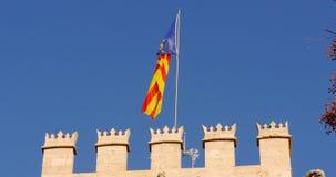 Blue sky national flag waving  on valencia silk exchange 4k spain. Europe stock video footage