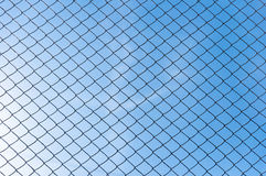 Blue sky through netting Stock Images