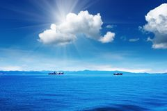 Blue sky and ocean Stock Photos