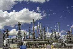 Blue sky with an oil refinery and pipes Royalty Free Stock Photography