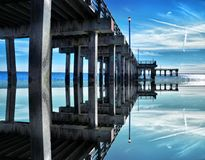 Blue sky and the old stone pier Stock Image