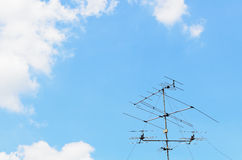 Blue sky with old tv antenna Stock Photo