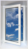 Blue sky through open window. View on blue sky through open plastic window Stock Images