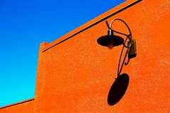 Blue sky orange wall Stock Images
