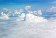Blue sky with ornamental clouds Stock Photos
