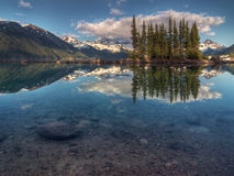 Blue sky over blue mountain lake Stock Image