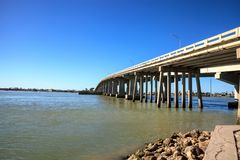 Blue sky over the bridge roadway that journeys onto Marco Island. Florida over the bay Stock Photography