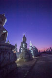 Blue sky over buddha statues Royalty Free Stock Photos