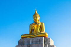 Blue sky over buddha statues Royalty Free Stock Images