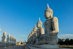 Blue sky over buddha statues Royalty Free Stock Image