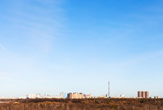 Blue sky over city in early spring Royalty Free Stock Images