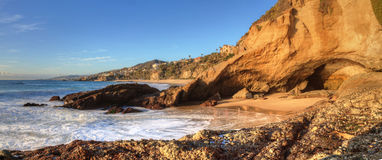 Blue sky over the coastline of One Thousand Steps Beach. With tidal pools and cliffs in Laguna Beach, California, USA Royalty Free Stock Image