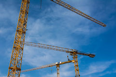 Blue Sky Over Construction Cranes Yellow Diagonal Copyspace Buil Stock Photo