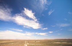 Blue sky over a dry desert Stock Photography