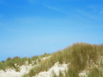 Blue sky over dunes Royalty Free Stock Photography