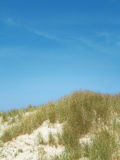 Blue sky over dunes Royalty Free Stock Photo