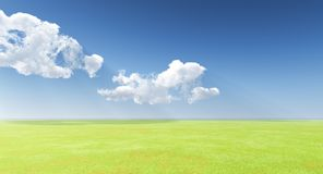 Blue sky over a green meadow Royalty Free Stock Image