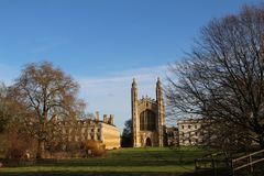 The Backs at Cambridge University England UK. Blue sky over the King`s College Chapel at The Backs park in Cambridge, UK Royalty Free Stock Image