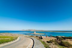 Blue sky over La Pelosa sea. And its Aragonese tower Stock Photography