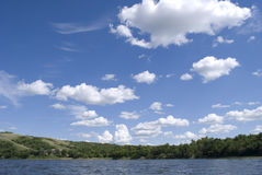 Blue sky over lake Stock Photography