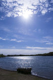 Blue Sky Over Lake With Dramatic Clouds And Sun Beams Stock Images