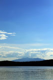 Blue sky over the mountain on the lake shore Royalty Free Stock Images