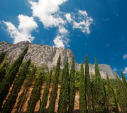 Blue sky over mountains. Crimean mountains on a beautiful day with trees at the foreground Stock Photography