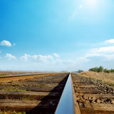 Blue sky over old railroad Stock Photography