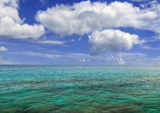 Blue sky over paradise water. Blue sky with clouds over paradise water Royalty Free Stock Images