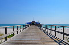 Blue sky over pier at Naples. Bluesky and boardwalk in Florida stock photo