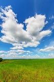 Blue sky over the plain Royalty Free Stock Photos