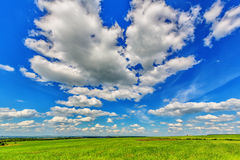 Blue sky over the plain Royalty Free Stock Image