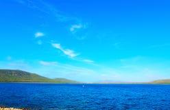 Blue sky over Porto Conte coast Stock Images