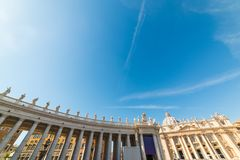 Blue sky over Saint Peter`s square colonnade Stock Image