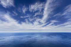 Blue sky over the sea. Blue cloudy sky over the sea royalty free stock photo